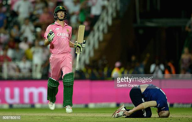 Chris Morris of South Africa scores the match leveling run as Ben Stokes of England reacts during the 4th Momentum ODI between South Africa and...