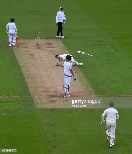 Chris Morris of South Africa throws his bat in the air after playing a return catch to Jimmy Anderson of England during Day Two of the 3rd Investec...