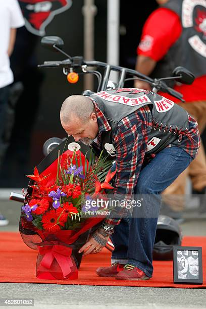 Chris Morris the father of Connor Morris picks up a bouquet of flowers following a memorial ride for the late Connor Morris on August 1 2015 in...