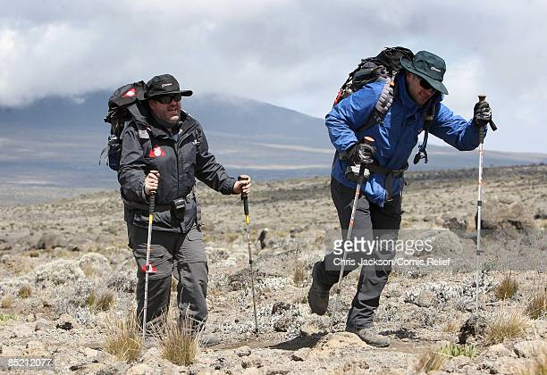 Chris Moyles and Ronan Keating trek on the third day of The BT Red Nose Climb of Kilimanjaro on March 4 2009 in Arusha Tanzania Celebrities Ronan...
