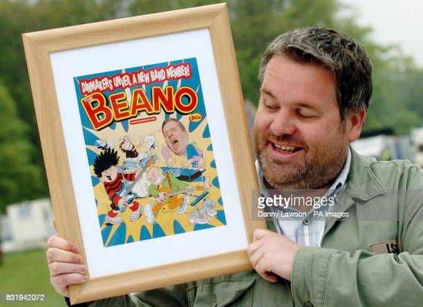 Chris Moyles host of Radio 1's Breakfast Show with a special print of a Beano front cover featuring himself Dennis and Gnasher The artwork was...