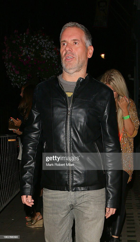 <a gi-track='captionPersonalityLinkClicked' href=/galleries/search?phrase=Chris+Moyles&family=editorial&specificpeople=220407 ng-click='$event.stopPropagation()'>Chris Moyles</a> leaving the Groucho club on September 10, 2013 in London, England.