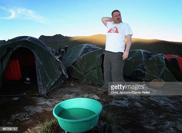 Chris Moyles washes on the second day of The BT Red Nose Climb of Kilimanjaro on March 1 2009 in Arusha Tanzania Celebrities Ronan Keating Gary...