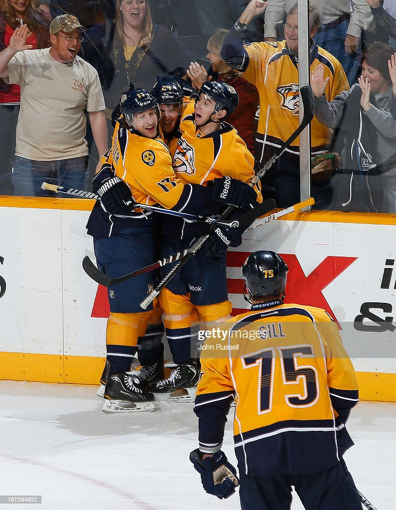 Chris Mueller #17 and Jonathon Blum #7 celebrate with Matt Halischuk #24 of the Nashville Predators after a goal against the Calgary Flames during an NHL game at the Bridgestone Arena on April 23, 2013 in Nashville, Tennessee.