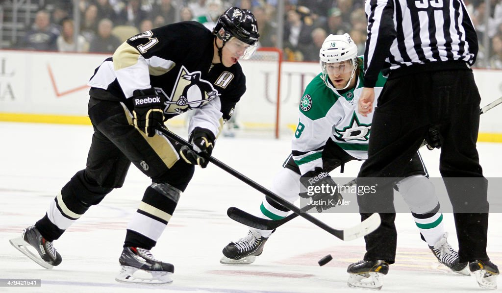 Chris Mueller of the Dallas Stars and Evgeni Malkin of the Pittsburgh Penguins take a faceoff during the game at Consol Energy Center on March 18...