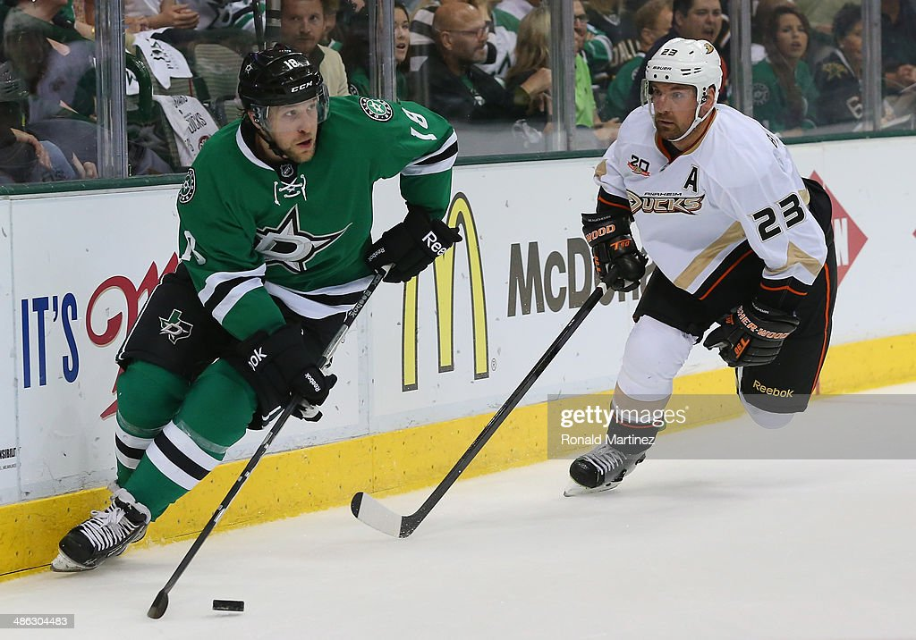 Chris Mueller of the Dallas Stars skates the puck against Francois Beauchemin of the Anaheim Ducks in the first period during Game Four of the First...