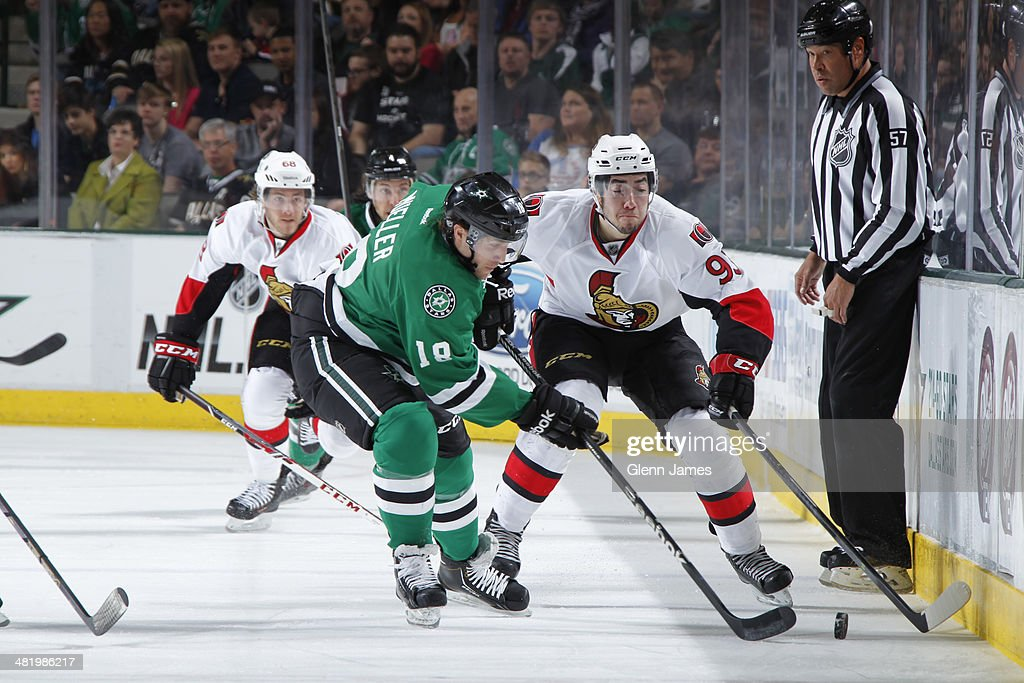 Chris Mueller of the Dallas Stars tries to keep the puck away against Mika Zibanejad of the Ottawa Senators at the American Airlines Center on March...