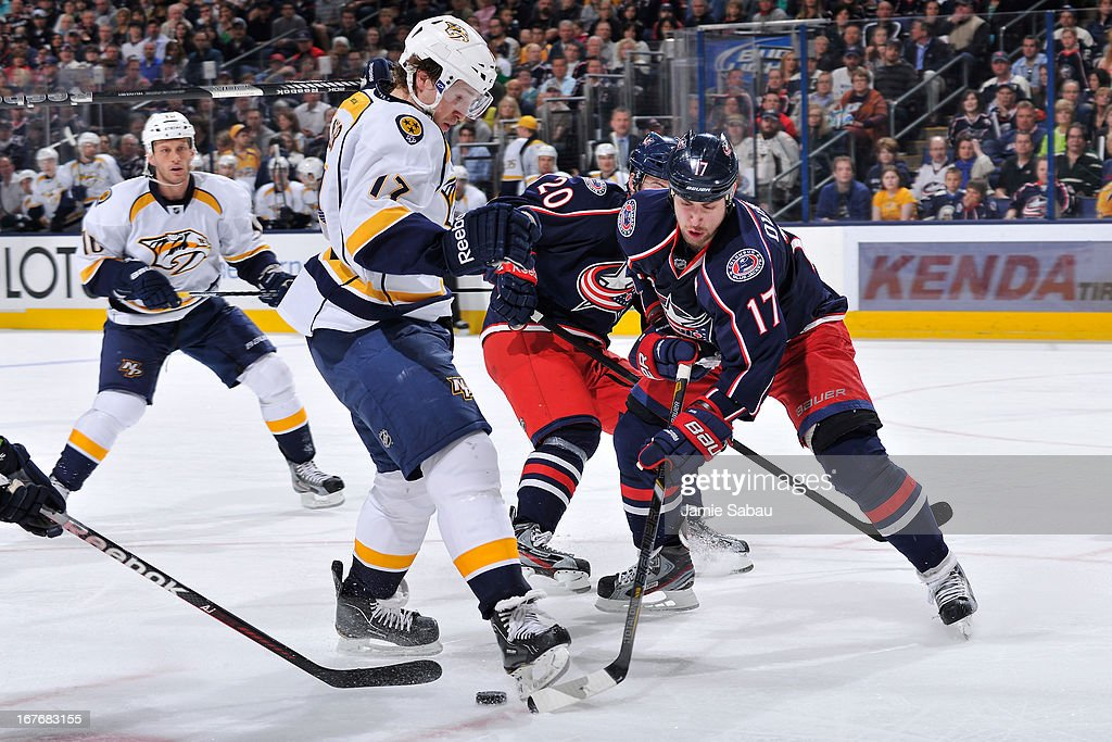 <a gi-track='captionPersonalityLinkClicked' href=/galleries/search?phrase=Chris+Mueller&family=editorial&specificpeople=575730 ng-click='$event.stopPropagation()'>Chris Mueller</a> #17 of the Nashville Predators steps on the stick of <a gi-track='captionPersonalityLinkClicked' href=/galleries/search?phrase=Brandon+Dubinsky&family=editorial&specificpeople=2271907 ng-click='$event.stopPropagation()'>Brandon Dubinsky</a> #17 of the Columbus Blue Jackets during the second period on April 27, 2013 at Nationwide Arena in Columbus, Ohio. <a gi-track='captionPersonalityLinkClicked' href=/galleries/search?phrase=Chris+Mueller&family=editorial&specificpeople=575730 ng-click='$event.stopPropagation()'>Chris Mueller</a> was given a 2 minute minor for holding. Columbus defeated Nashville 3-1.