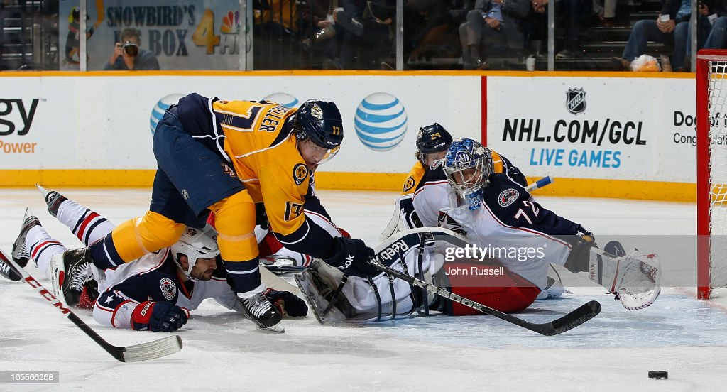 Chris Mueller #17 of the Nashville Predators tries to reach a loose puck against Sergei Bobrovsky #72 of the Columbus Blue Jackets during an NHL game at the Bridgestone Arena on April 4, 2013 in Nashville, Tennessee.