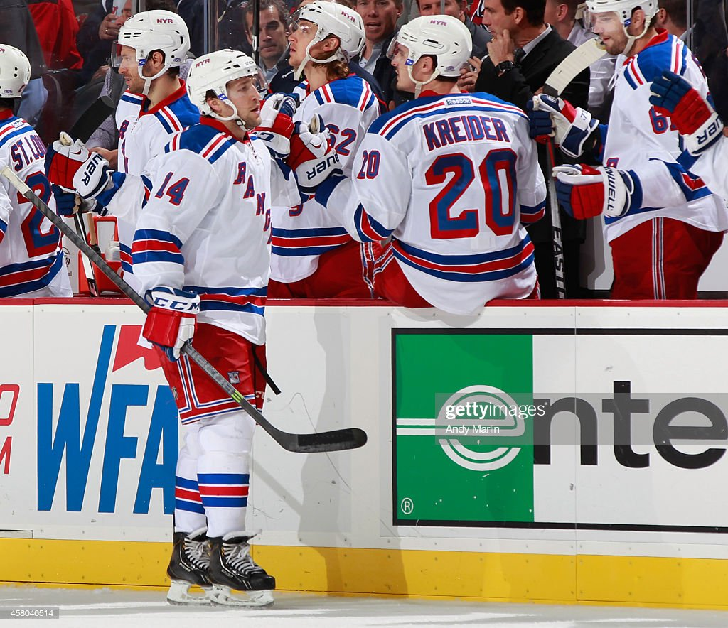 Chris Mueller of the New York Rangers is congratulated after scoring a goal against the New Jersey Devils during the game at the Prudential Center on...