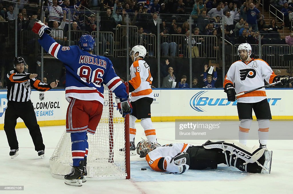 Chris Mueller of the New York Rangers scores a powerplay goal at 1418 of the second period against Steve Mason of the Philadelphia Flyers at Madison...