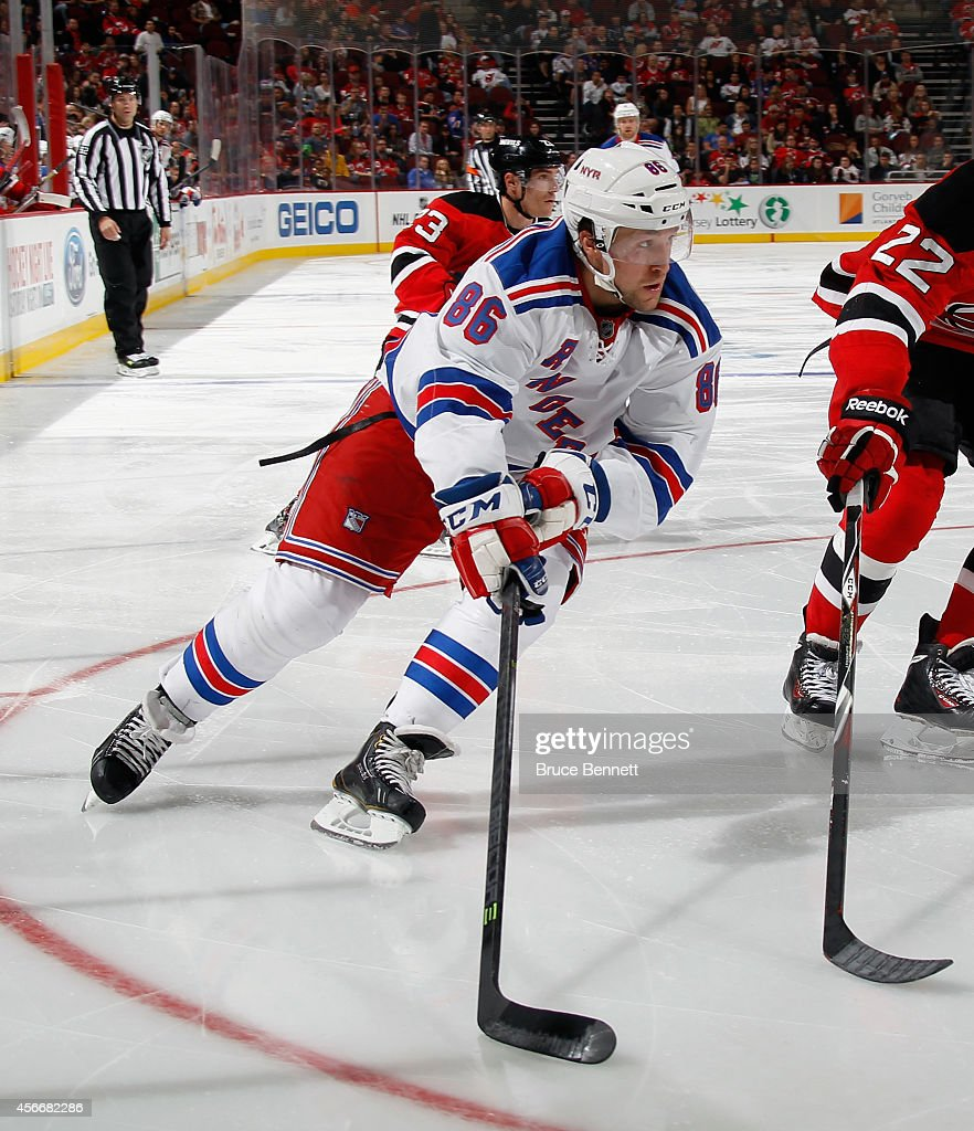 Chris Mueller of the New York Rangers skates against the New Jersey Devils at the Prudential Center on October 4 2014 in Newark New Jersey The Devils...