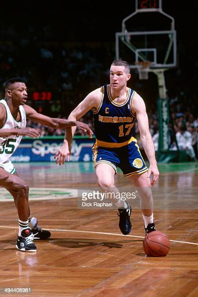 Chris Mullin of the Golden State Warriors drives against the Boston Celtics during a game played in 1992 at the Boston Garden in Boston Massachusetts...