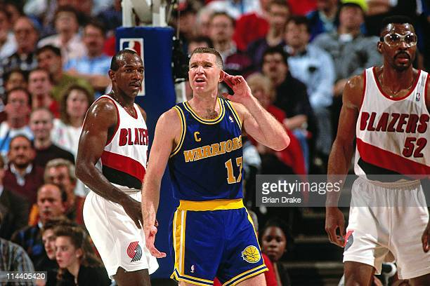 Chris Mullin of the Golden State Warriors looks on against the Portland Trailblazers at the Veterans Memorial Coliseum in Portland Oregon circa 1992...
