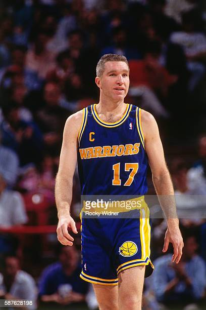Chris Mullin of the Golden State Warriors looks on during the game against the Sacramento Kings at the Alameda County Coliseum Arena in Oakland...