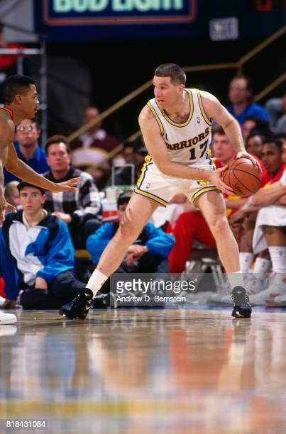 Chris Mullin of the Golden State Warriors looks to pass against the Atlanta Hawks during a game at OaklandAlameda County Coliseum Arena in Oakland...