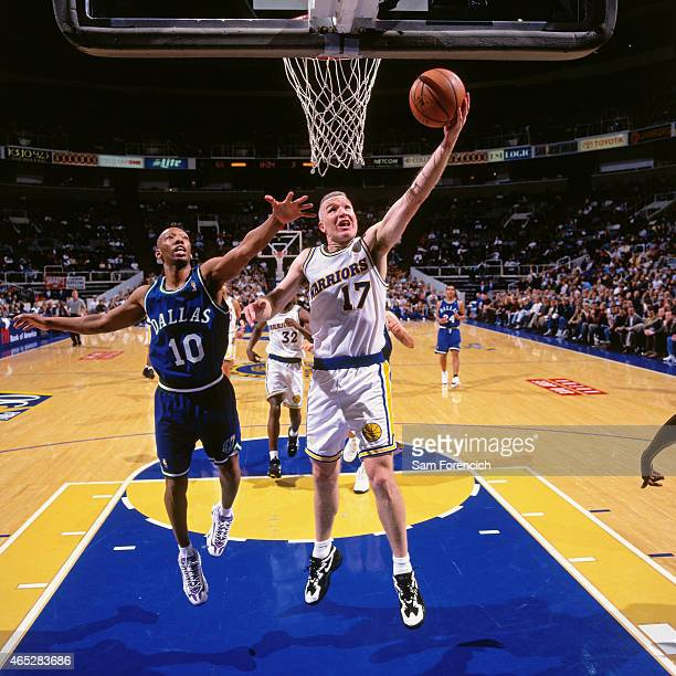 Chris Mullin of the Golden State Warriors shoots against Sam Cassell of the Dallas Mavericks on January 21 1997 at The Arena in Oakland California...