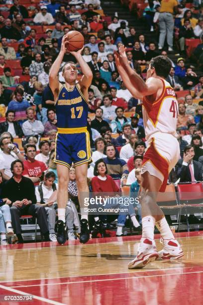 Chris Mullin of the Golden State Warriors shoots against the Atlanta Hawks during a game played circa 1990 at the Omni in Atlanta Georgia NOTE TO...