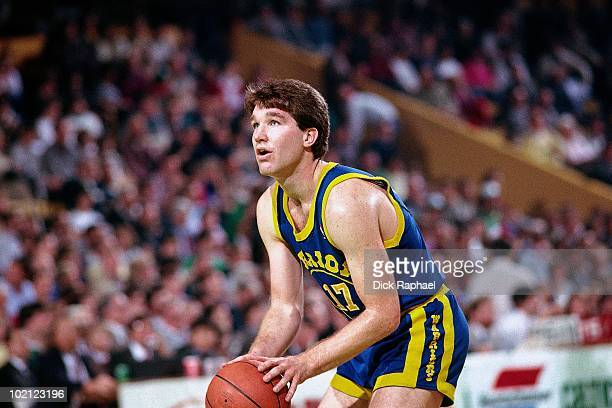 Chris Mullin of the Golden State Warriors shoots against the Boston Celtics during a game played in 1987 at the Boston Garden in Boston Massachusetts...