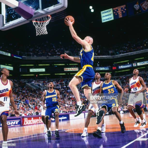 Chris Mullin of the Golden State Warriors shoots against the Phoenix Suns circa 1997 at America West Arena in Phoenix Arizona NOTE TO USER User...