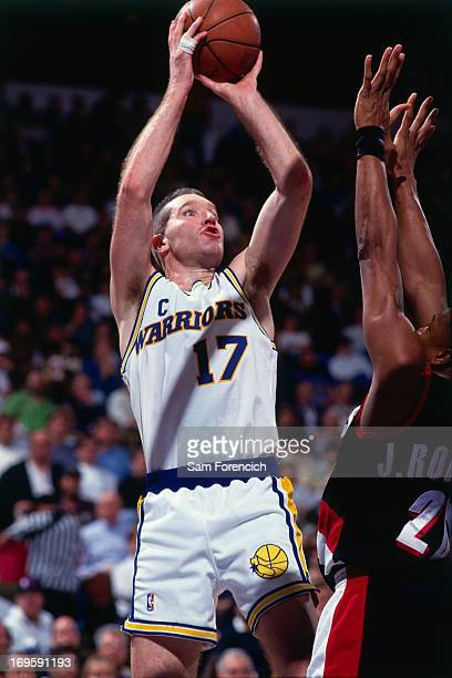Chris Mullin of the Golden State Warriors shoots the ball against the Portland Trail Blazers circa 1994 at the OaklandAlameda County Coliseum Arena...