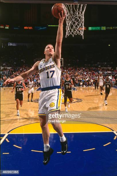 Chris Mullin of the Golden State Warriors shoots the ball during a game played circa 1995 at the Oakland Coliseum in Oakland California NOTE TO USER...