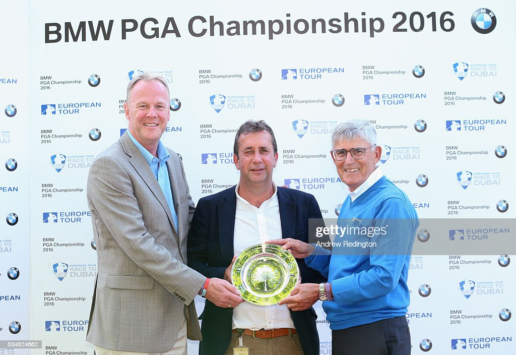 Chris Myers (C) of Doha Golf Club poses with his Outstanding Contribution award with David Probyn (L), The European Tour Tournament Director and David Williams, Chairman of The European Tour during day one of the BMW PGA Championship at Wentworth on May 26, 2016 in Virginia Water, England.