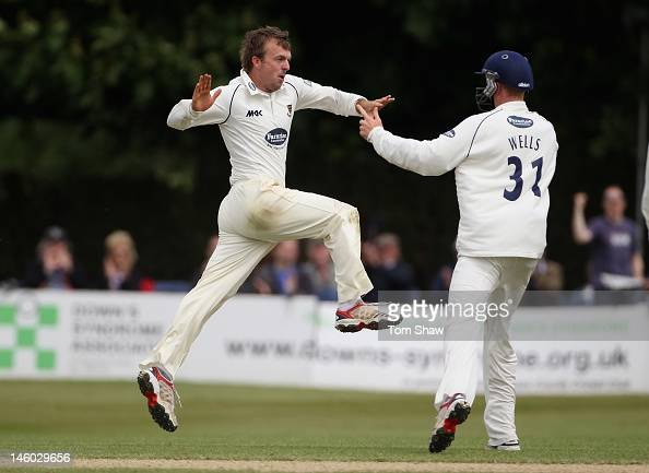 Chris Nash of Sussex celebrates taking the wicket of Tom Maynard of Surrey during day 4 of the LV= County Championship match between Sussex and...