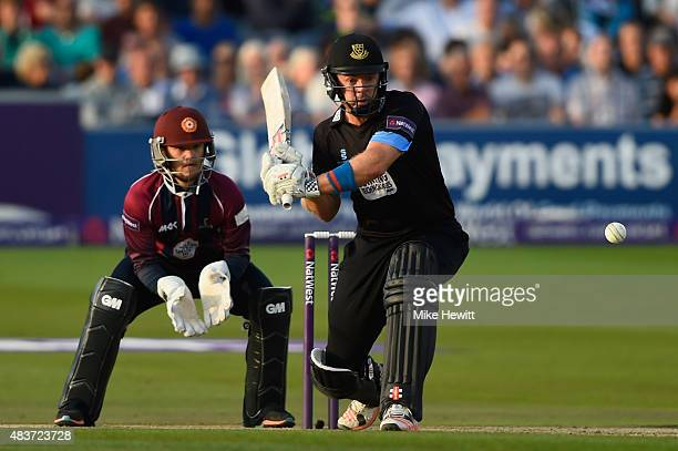 Chris Nash of Sussex hits out as wicketkeeper Ben Duckett of Northamptonshire looks on during the NatWest T20 Blast Quarter Final between Sussex...