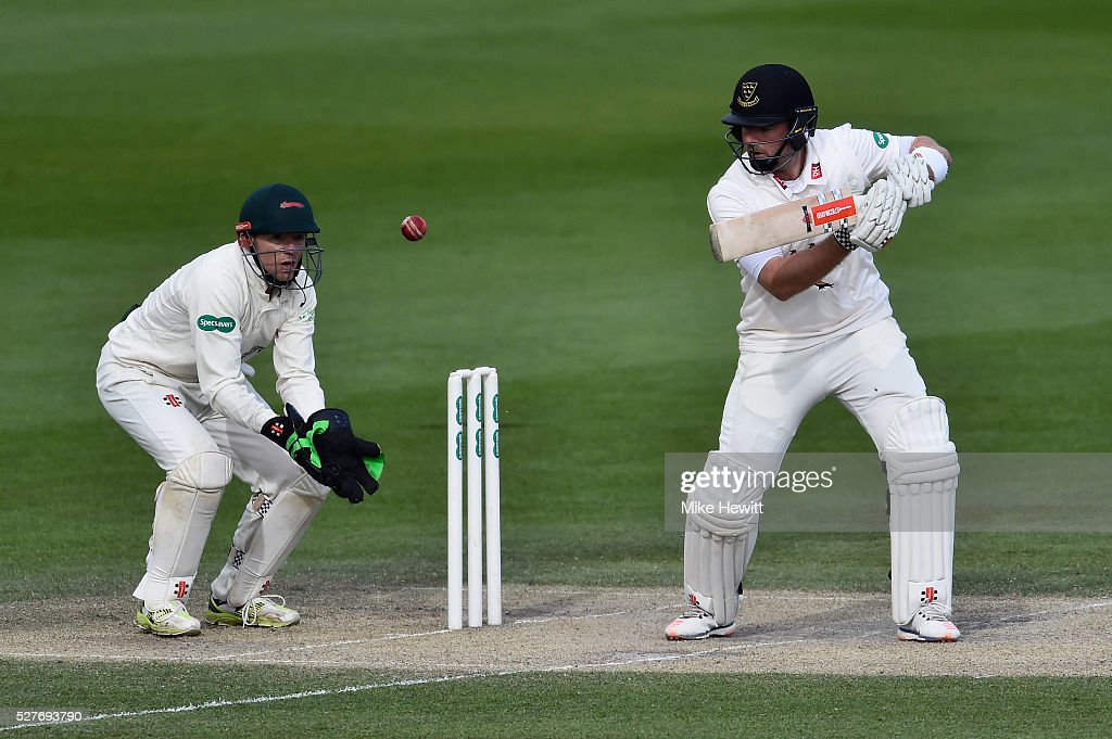 Chris Nash of Sussex hits out as wicketkeeper Niall O'Brien of Leicestershire looks on during the Specsavers County Championship Division Two match between Sussex and Leicestershire on May 03, 2016 in Hove, England.