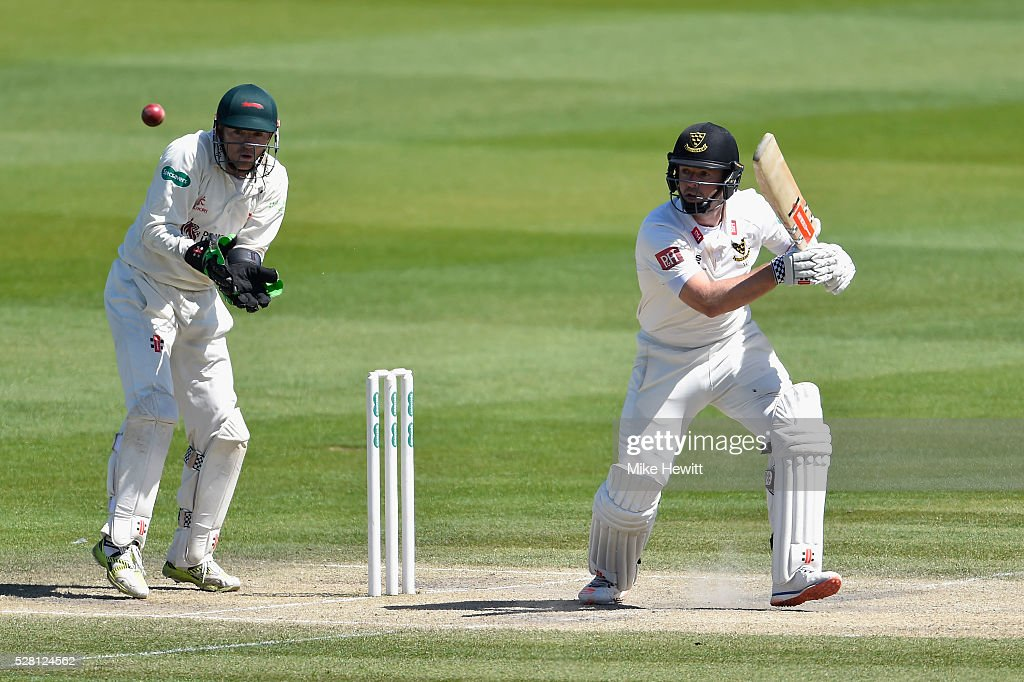 Chris Nash of Sussex hits out as wicketkeeper <a gi-track='captionPersonalityLinkClicked' href=/galleries/search?phrase=Niall+O%27Brien+-+Cricketer&family=editorial&specificpeople=7528561 ng-click='$event.stopPropagation()'>Niall O'Brien</a> of Leicestershire looks on during the fourth day of the Specsavers County Championship Division Two match between Sussex and Leicestershire on May 04, 2016 in Hove, England.