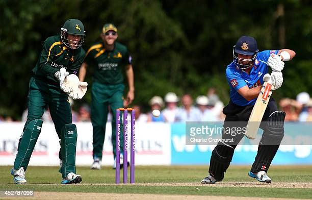 Chris Nash of Sussex hits out while Chris Read of Nottinghamshire looks on during Royal London OneDay Cup match between Sussex Sharks and...