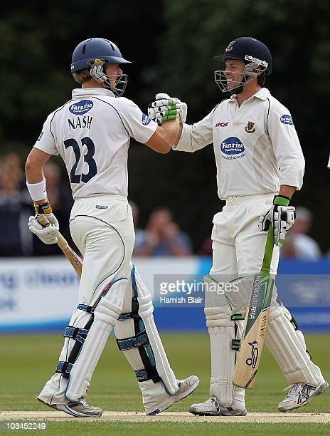 Chris Nash of Sussex is congratulated on his century by team mate Ed Joyce during day two of the LV County Championship Division Two match between...