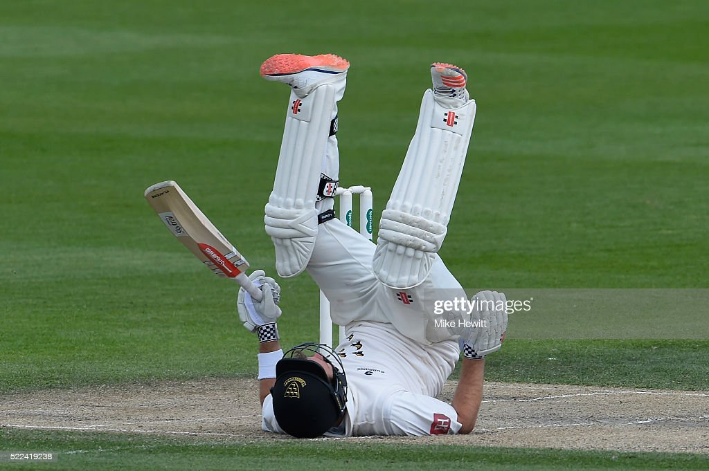 Chris Nash of Sussex is floored after being hit by a short ball from Jamie Porter of Essex during the Specsavers County Championship Division Two...