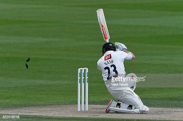 Chris Nash of Sussex loses a part of his helmet after being hit by a short ball from Jamie Porter of Essex during the Specsavers County Championship...