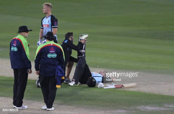Chris Nash of Sussex receives treatment for cramp during the Sussex v Essex NatWest T20 Blast cricket match at the 1st Central County Ground on...