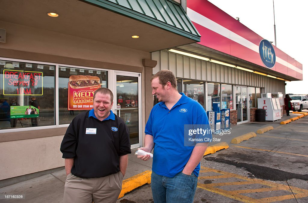 Chris Nauerz, manager, and Baron Hartell, Trex Mart management, right, laugh outside the Trex Mart gas station at 17605 Highway Z in Dearborn, Missouri, where one of the winning Powerball lottery tickets was sold inside the gas station. The location of the winning tickets was announced on Thursday, November 29, 2012.