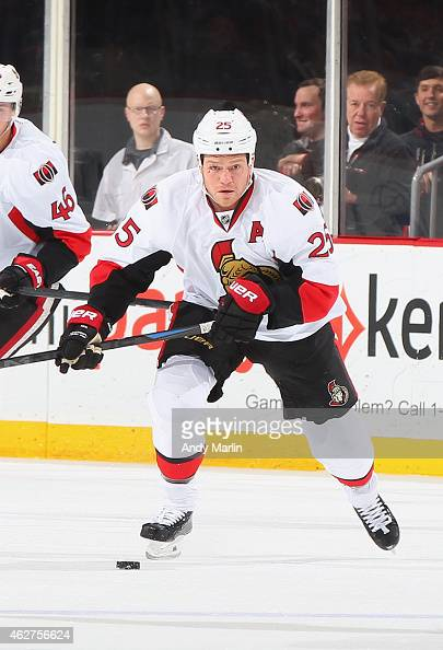 Chris Neil 325 of the Ottawa Senators plays the puck during the game against the New Jersey Devils at the Prudential Center on February 3 2015 in...