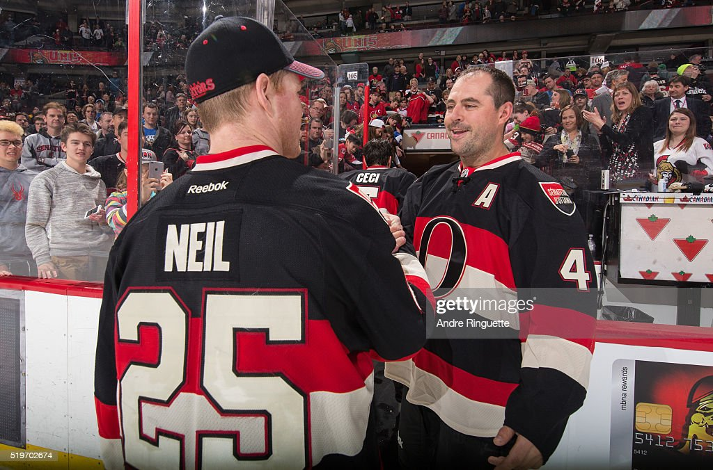 Chris Neil and Chris Phillips of the Ottawa Senators shake hands as they leave the ice after the last home game of the season against the Florida...