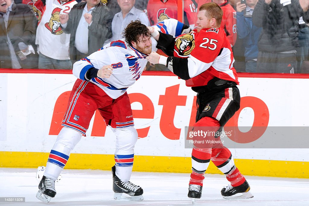 Chris Neil #25 of the Ottawa Senators and <a gi-track='captionPersonalityLinkClicked' href=/galleries/search?phrase=Brandon+Prust&family=editorial&specificpeople=2221796 ng-click='$event.stopPropagation()'>Brandon Prust</a> #8 of the New York Rangers fight in Game Six of the Eastern Conference Quarterfinals during the 2012 NHL Stanley Cup Playoffs at the Scotiabank Place on April 23, 2012 in Ottawa, Ontario, Canada.