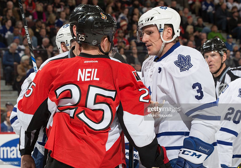 Chris Neil of the Ottawa Senators and Dion Phaneuf of the Toronto Maple Leafs have words during a scrum at Canadian Tire Centre on February 6 2016 in...