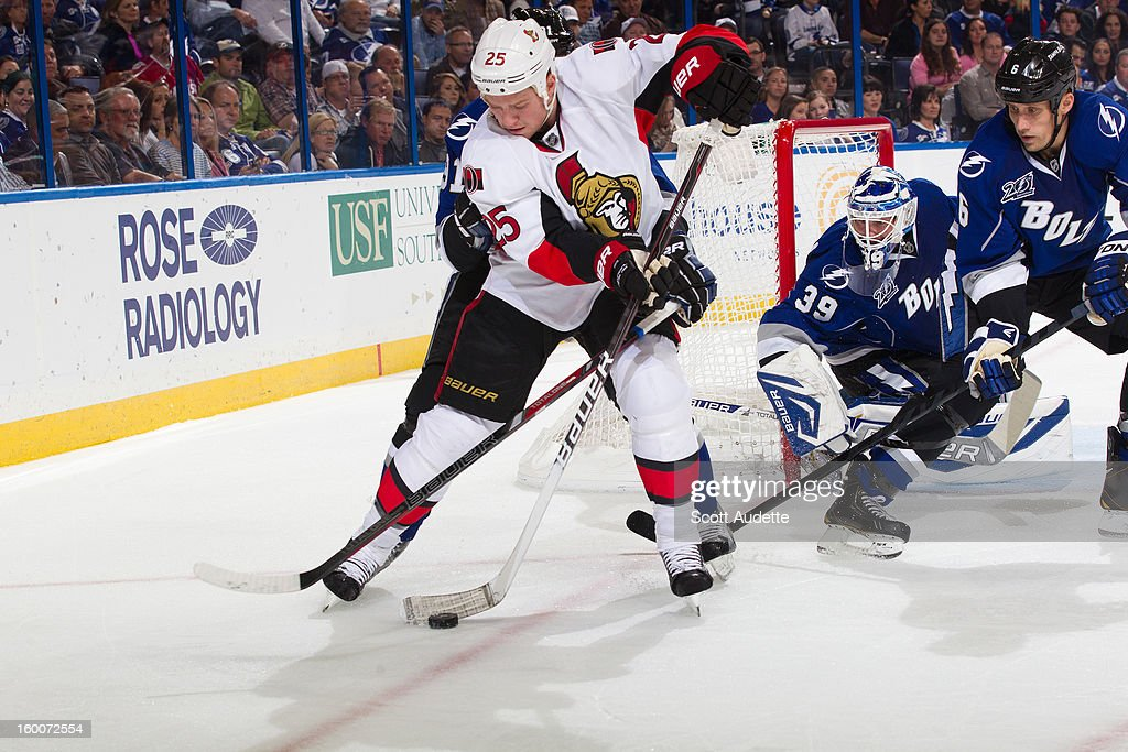 Chris Neil #25 of the Ottawa Senators battles against the Tampa Bay Lightning during the second period at the Tampa Bay Times Forum on January 25, 2013 in Tampa, Florida.