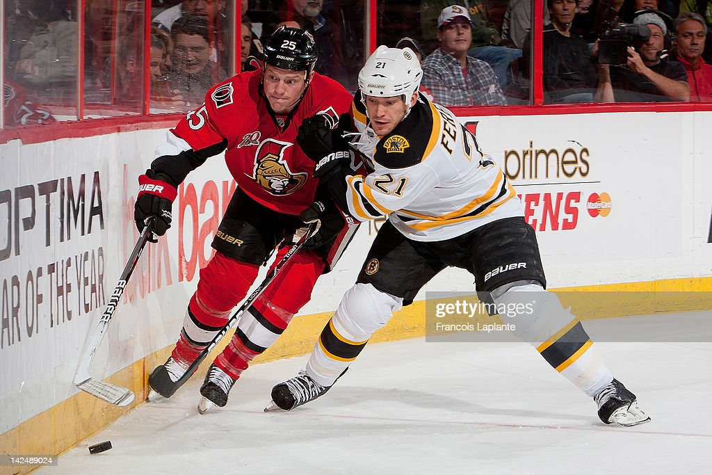 Chris Neil #25 of the Ottawa Senators battles along the boards against <a gi-track='captionPersonalityLinkClicked' href=/galleries/search?phrase=Andrew+Ference&family=editorial&specificpeople=202264 ng-click='$event.stopPropagation()'>Andrew Ference</a> #21 of the Boston Bruins at Scotiabank Place on April 5, 2012 in Ottawa, Ontario, Canada.