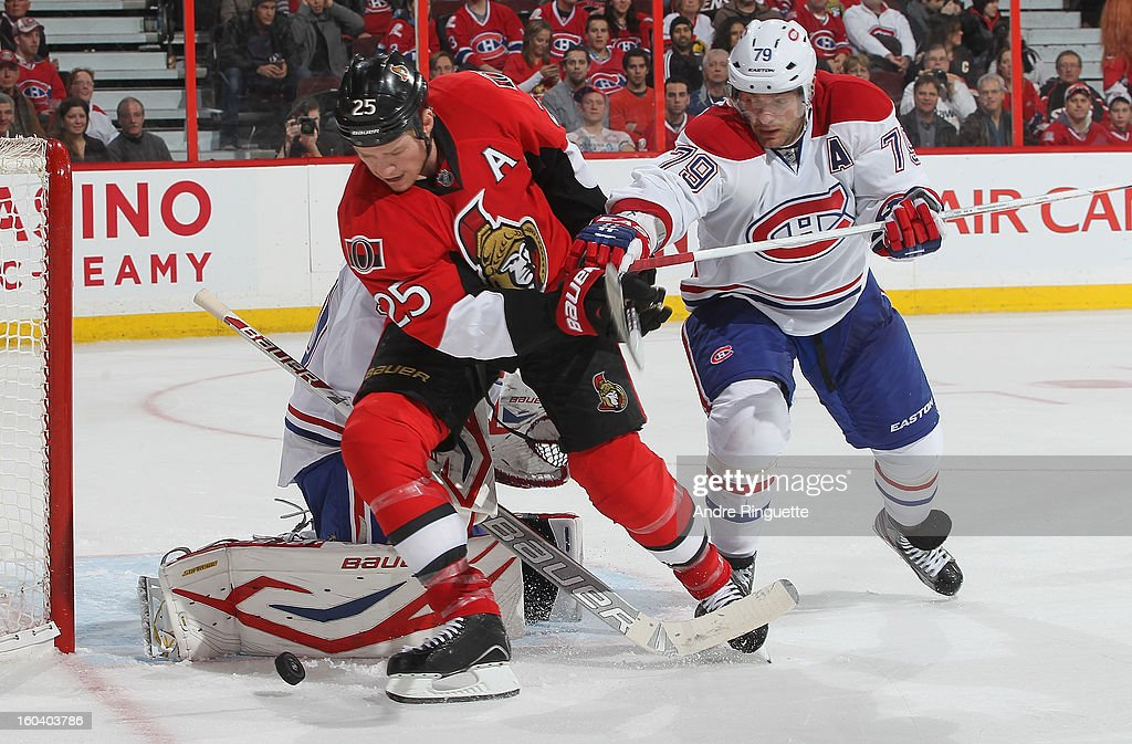 Chris Neil #25 of the Ottawa Senators battles for a rebound against <a gi-track='captionPersonalityLinkClicked' href=/galleries/search?phrase=Andrei+Markov&family=editorial&specificpeople=204528 ng-click='$event.stopPropagation()'>Andrei Markov</a> #79 of the Montreal Canadiens on January 30, 2013 at Scotiabank Place in Ottawa, Ontario, Canada.