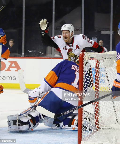 Chris Neil of the Ottawa Senators celebrates a third period goal by JeanGabriel Pageau against Thomas Greiss of the New York Islanders at the...