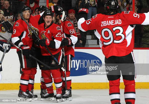 Chris Neil of the Ottawa Senators celebrates his first period powerplay goal against the Winnipeg Jets with teammates Milan Michalek Mike Hoffman and...