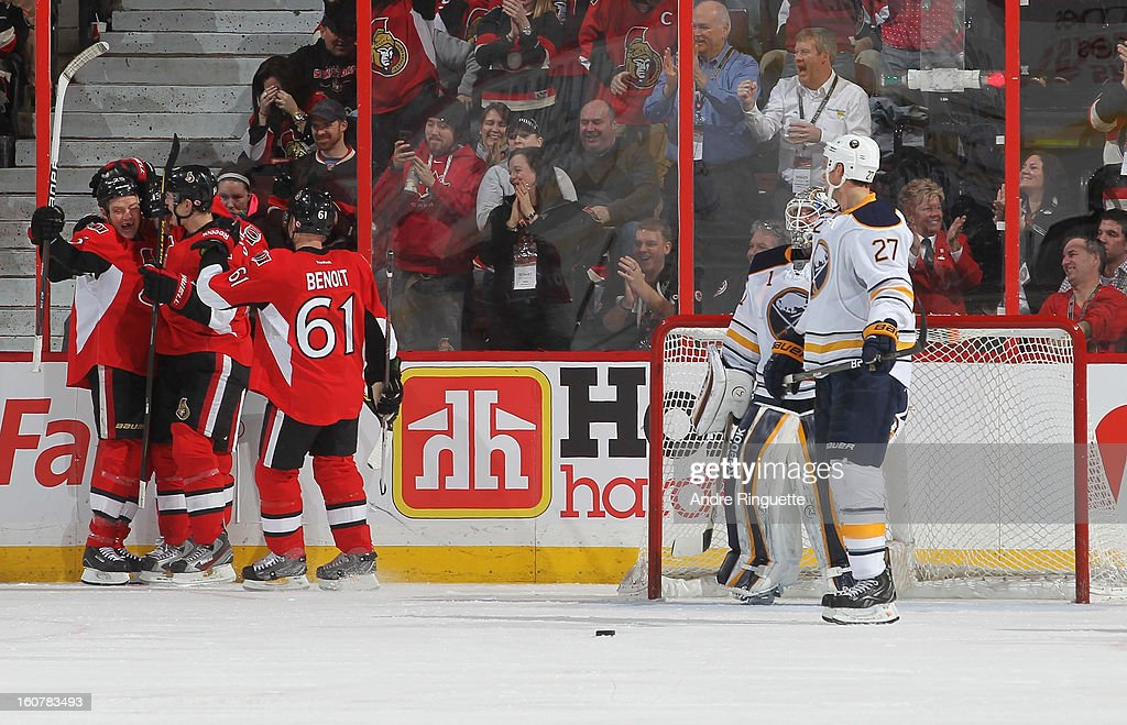 Chris Neil #25 of the Ottawa Senators celebrates his second period goal with teammates Colin Greening #14 and Andre Benoit #61 as Jhonas Enroth #1 and Adam Pardy #27 of the Buffalo Sabres look on on February 5, 2013 at Scotiabank Place in Ottawa, Ontario, Canada.