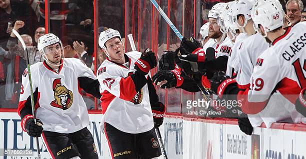 Chris Neil of the Ottawa Senators celebrates his second period goal against the Anaheim Ducks with team mate Nicholas Paul at Canadian Tire Centre on...