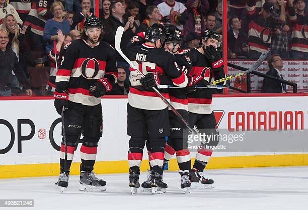 Chris Neil of the Ottawa Senators celebrates his third period goal against the New Jersey Devils with teammates Jared Cowen Shane Prince and Cody...
