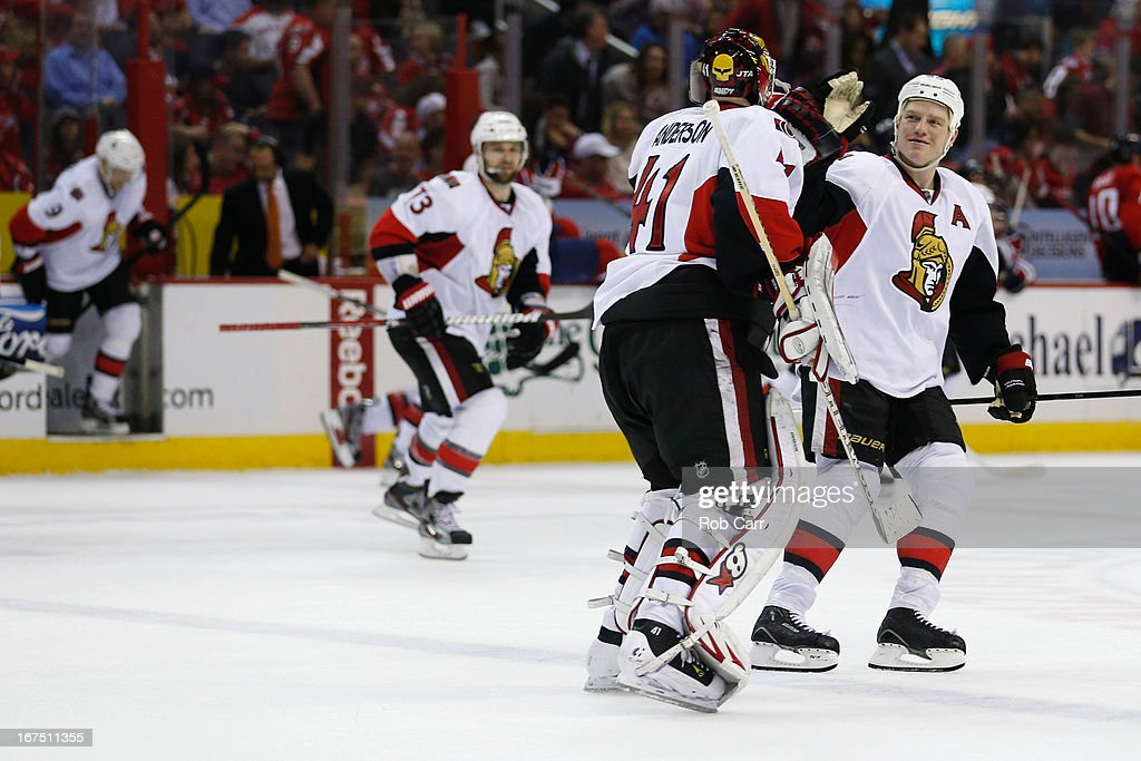 Chris Neil #25 of the Ottawa Senators celebrates with goalie <a gi-track='captionPersonalityLinkClicked' href=/galleries/search?phrase=Craig+Anderson&family=editorial&specificpeople=211238 ng-click='$event.stopPropagation()'>Craig Anderson</a> #41 after the Senators defeated the Washington Capitals 2-1 at Verizon Center on April 25, 2013 in Washington, DC.